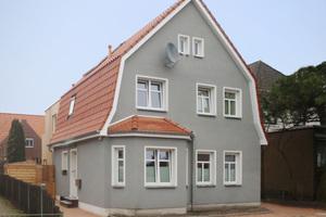 Einfamilienhaus mit Kratzputz: Kratzputze mit aufgerauter Oberfläche gibt es schon seit dem 14. Jahrhundert