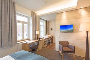 Stilvolles und komfortables Übernachten garantiert: Hochschalldämmende Trennwände sorgen für die notwendige Ruhe, elegant platzierte Leuchtkörper für ein hohes Maß an Gemütlichkeit