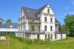 In einer Industriellen-Villa aus dem 19. Jahrhundert entstanden nach Sanierung und Umbau vier voneinander unabhängige Wohneinheiten
