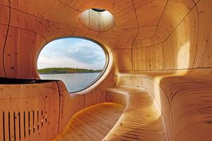 """Die vom kanadischen Architekturbüro Partisans für die im Huronsee gelegene Privatinsel Sans Souci entworfene Sauna besteht im Inneren aus 3D-gefrästen Zedernholz-Paneelen, die wie von der Brandung in Form gewaschener Stein wirken<div class=""""bildnachweis"""">Fotos: Jonathan Friedman / Partisans</div>"""