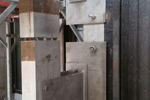 Die Unterkonstruktion für die vorgehängte hinterlüftete Natursteinfassade besteht aus einer Edelstahl-Aluminium-Unterkonstruktion