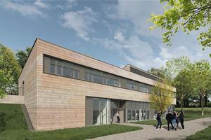 Die neuen Fassaden bestehen aus Keramikschindeln. In ihrer Optik kommen sie den abgängigen Holzschindeln sehr nahe.