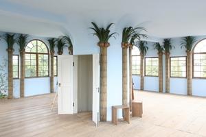 Über eine Hängetreppe im Mezzanin (Zwischengeschoss) gelangt man in den Palmensaal
