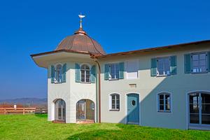Der sanierte Pavillon mit Kupferdach und traditioneller Wetterfahne Foto/Montage: Knauf Aquapanel/Ekkehart Reinsch