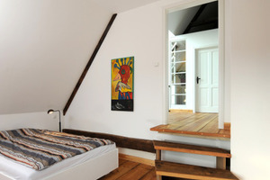 Der Höhenversatz wird im Dachgeschoss mit einer kleinen Treppe überwunden<br />