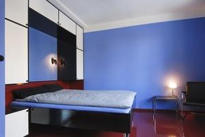 Das blaue Schlafzimmer mit Klappbett im Obergeschoss<br />