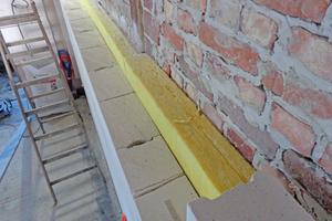 Mineralwollplatten bringen den Brandschutz zum Nachbargebäude auf F90