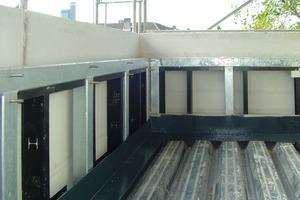 """<div class=""""99 Bildunterschrift_negativ"""">In die Metallkonstruktion wird zur Montage der Zementbauplatten eine korrosionsgeschützte Unterkonstruktion gesetzt</div>"""