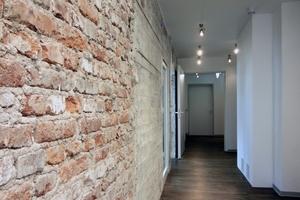 Unverputzte Wandabschnitte zeigen im dritten Obergeschoss die originale Bausubstanz des Bunkers
