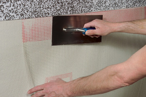 In Kombination mit einem speziellen Systemgewebe bietet die Dämmung mit Carbontechnologie wirksamen Schutz für mechanisch stark beanspruchte Fassaden
